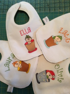 Quilted baby bibs: Flower Pot Kids embroidery design
